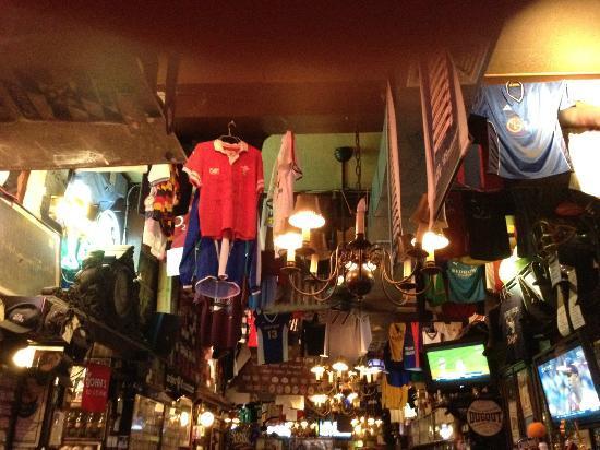 Foley's Pub & Restaurant: a lot of sport shirts