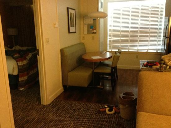 HYATT house Denver Airport: eating area next to entrance to separate bedroom and bathroom