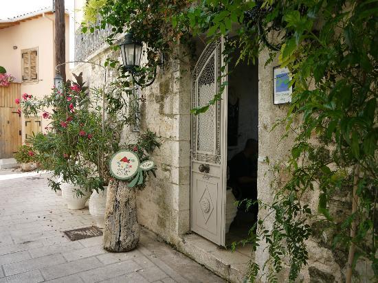 The Aigli: entrance of Aigli hotel, lovely street