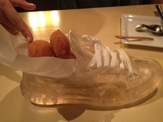 The Bazaar by Jose Andres: chicken croquets presented in a glass Converse shoe - fun!