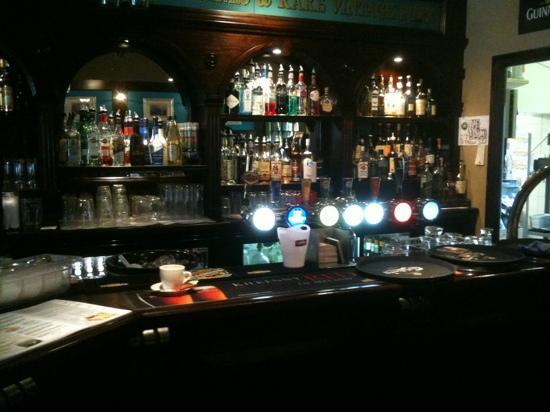 The 3 Tells Irish Pub: part of the bar