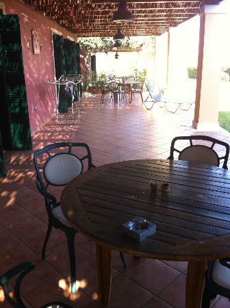 Villa Rosa: Patio area adjoining next doors patio