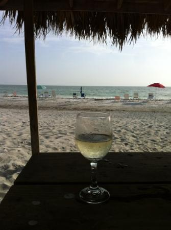 Gulf Beach Resort Motel: enjoying a glass of wine on the beach outside our room