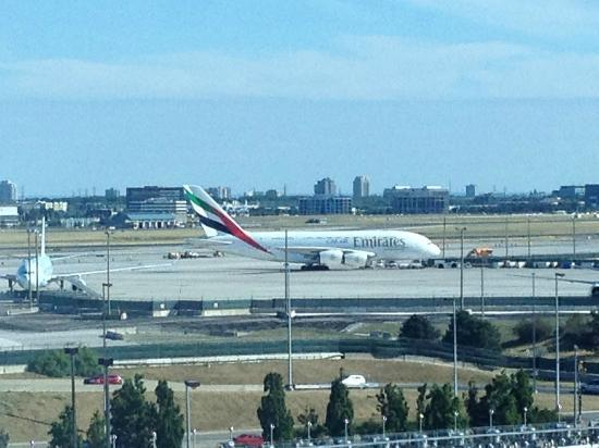 Hilton Toronto Airport Hotel & Suites: Another airport view from the room  and  an unexpected sighting of an A380