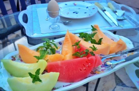 Enchanted April Inn: Fresh melons and soft cooked egg in egg cup.