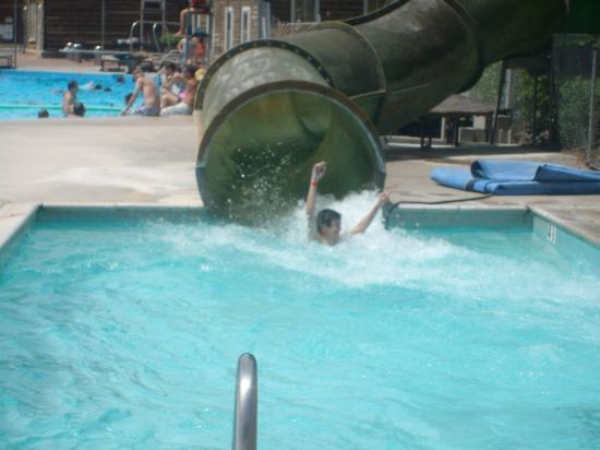 Son coming down the waterslide at Heise Hot Springs