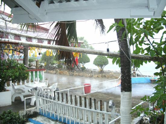 Whispering Beach Resort: another view from the entrance to the room in the rain