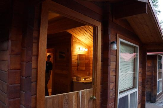 The Cabins at Denali Park Village: That's the whole room- I am outside, hubby in bathroom