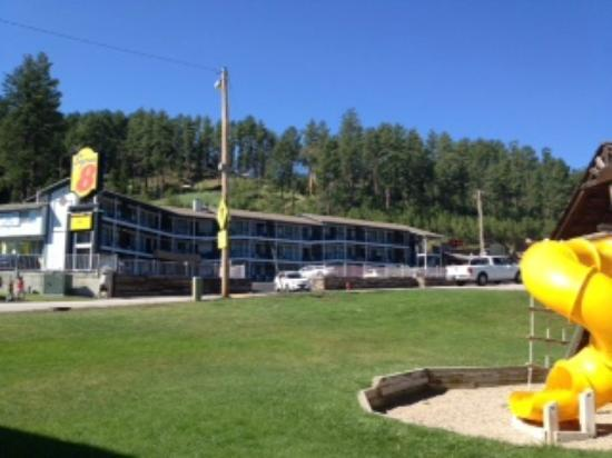 Super 8 Keystone/Mt. Rushmore: View of the motel from the playground/coffeeshop across the highway.