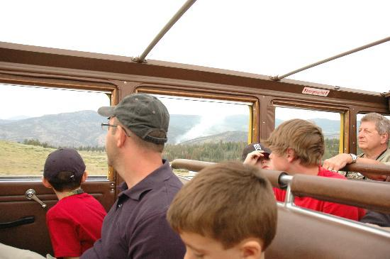 Historic Yellow Bus Tour: Passengers viewing a forest fire from bus