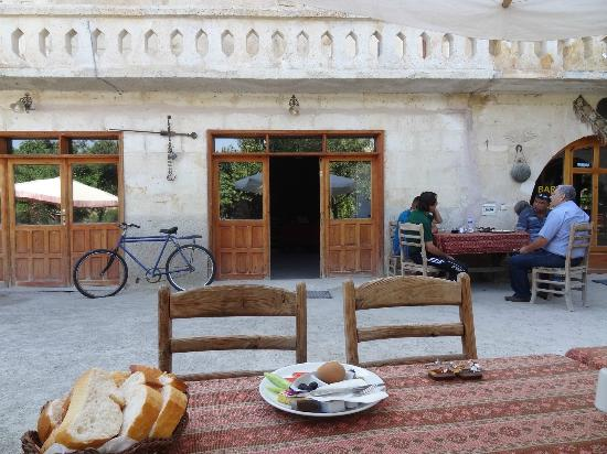Gumus (Silver) Cave Hotel: Morning in the garden area -- Kavalta is on table.