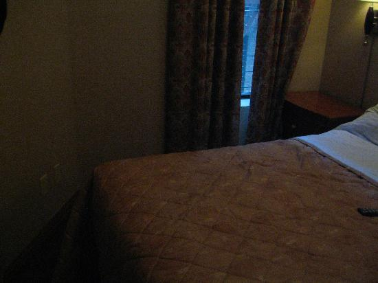 Belnord Hotel: View of bedroom (2) - note how close the corner of the bed is to the wall!