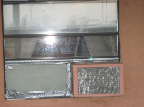 Logan Lodge:                                     Window-mount air conditioner from outside(duct taped in)