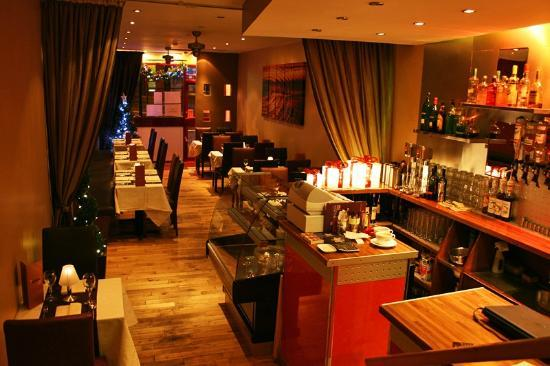 Saffron: A view of the warm interior from the back of the restaurant