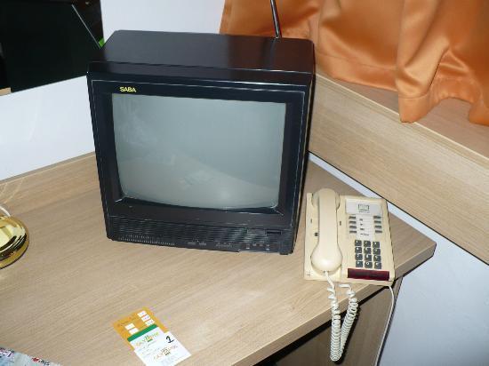Olympik Hotel Prague: old tv and phone