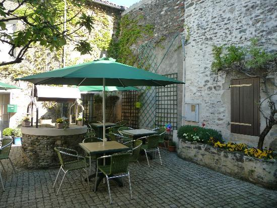 CAFE COUR du MIRACLE: The courtyard - a place to relax in the sun or shade