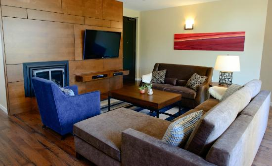 Two Thirty-Five: Luxury Suites: The living room in the Fitch Mountain Suite offers a 55-inch TV and fireplace.