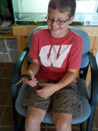 Chippewa Moraine Ice Age State Recreation Area: Holding one of the snakes inside the exhibition center.