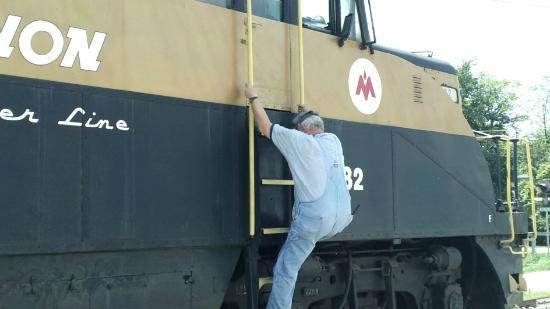 Kentucky Railway Museum: This an engineer climbing down the other engine. This engine is pretty special, but not the anti