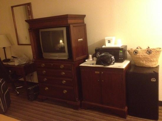 Quality Inn & Suites: Mini fridge, microwave, and coffee in room. TV is dated but functional.