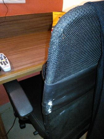 Ginger Ahmedabad: Poor quality torn fabric writing desk chair