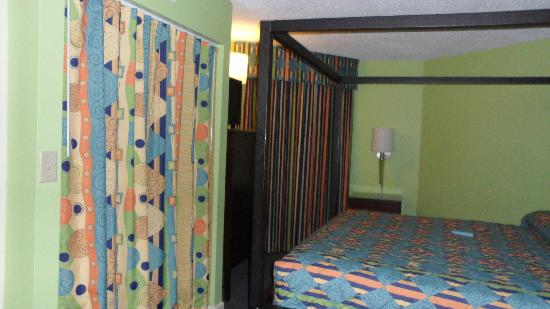 The Strand A Boutique Resort: That colorful curtain to the left is closet. Its huge!