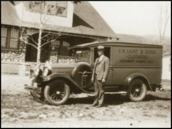 F.M. Light & Sons: Clarence Light, with the truck that was used to sell clothing to ranches during the Depression