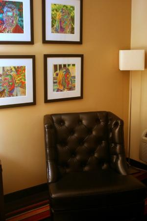 Crowne Plaza Hotel New Orleans Airport: Somewhat creepy art above the armchair, but I've seen far worse hotel decor.