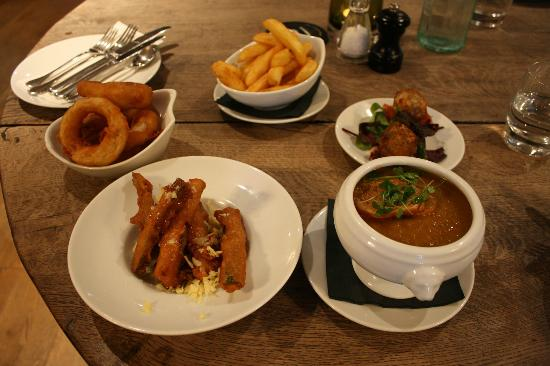 "The Plough Inn: Onion Rings, ""hand cut"" chips (1.99e) Vegetable Soup (3.95) Courgette Fritters, Risotto balls"