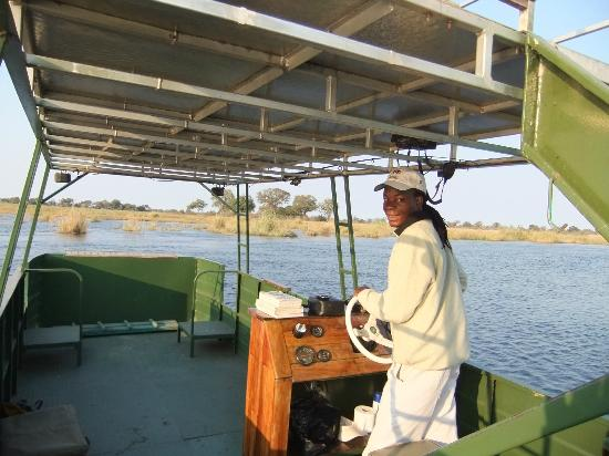 Lagoon Camp - Kwando Safaris: Aron piloting the boat