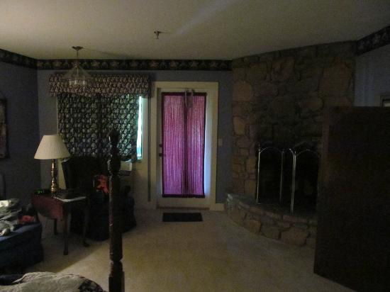 Inn at Blue Ridge: A veiw from inside the Wood Anemone room, showing the fireplace and door out to the balcony.