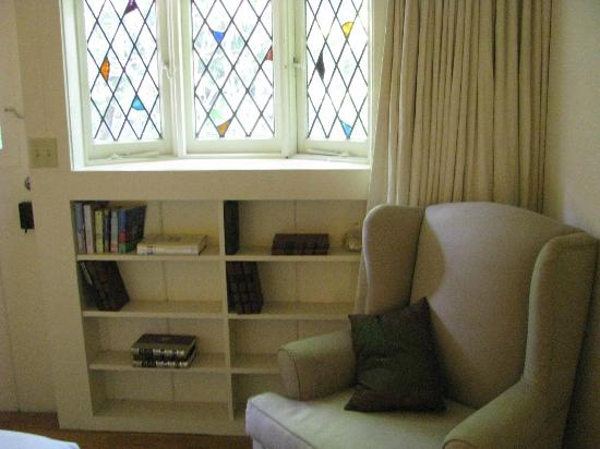 The Charlie: stained glass windows in master bedroom reading area