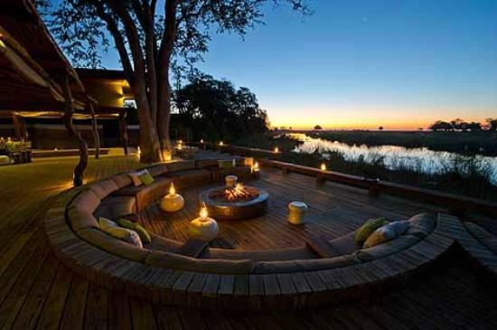 Wilderness Safaris Kings Pool Camp: Sunken Lounge with Stargazing Fire Deck at Kings Pool Camp