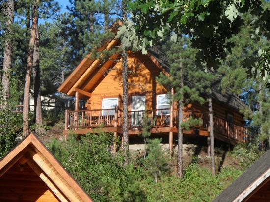 front of 6 picture of rustic ridge guest cabins