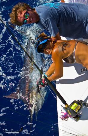 Panoply Sport Fishing & Luxury Charters : Trish helps Jacob release his first Blue Marlin