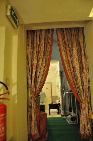 Hotel San Salvador: our room was beyond these curtains off the lobby