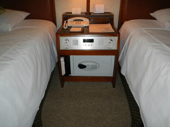 beds night stand and safe Picture of Grand Prince Hotel