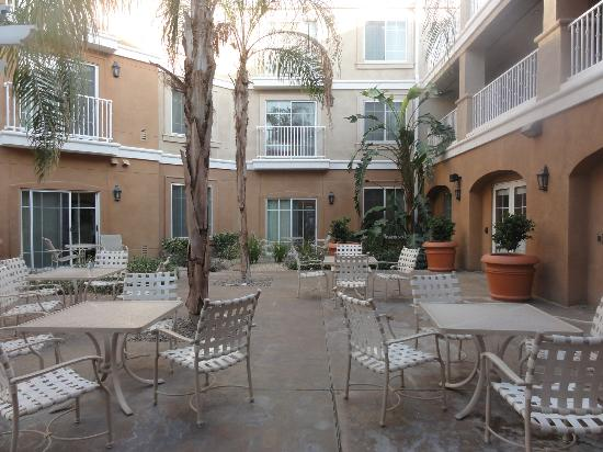 Homewood Suites by Hilton La Quinta: courtyard area near room 105