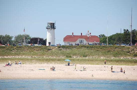 The Old Harbor Inn: The Chatham Light watches over sun bathers