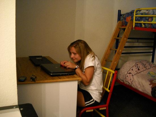 Super 8 Gurnee: Daughter being silly at desk near bunk beds.