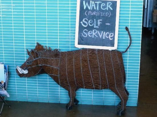 Nina's Real Food: Beaded warthog sign holder.