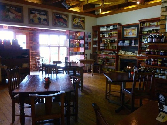 INFOOD Deli/Restuarant: Tables and shelving with bottled preserves