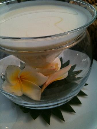 Breakfast yogurt served with a Kiridara flower.