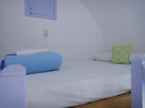 Pelagos Hotel-Oia: Room 10 - Double bed in the eves of the building