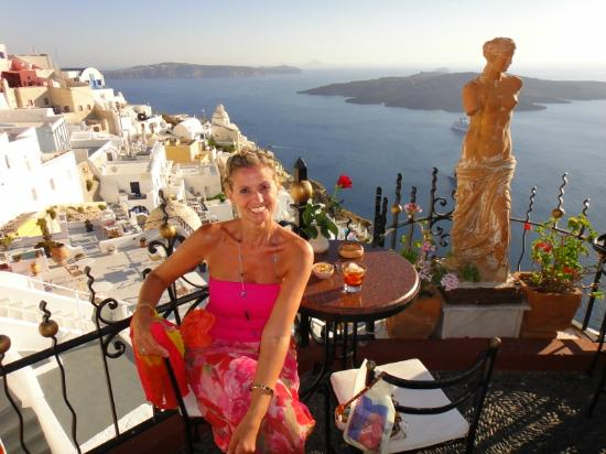 Pelagos Hotel-Oia: Jules in Fira enjoying the sunset - caldera in background