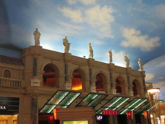 Roman Statues At The Shops And Painted Sky Ceiling