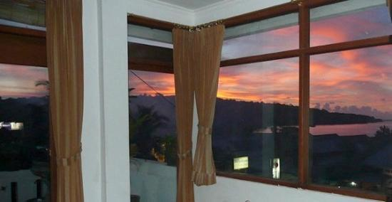 Jimbaran Bay Beach Residence: Beautiful sunset view from the White House third floor bedroom