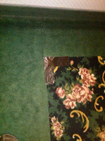 Comfort Inn & Suites : Duct Tape on Carpet