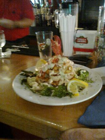 Trade Winds Inn: lobster tower with haddock at base popcorn shrimp scallops and a light cream sauce