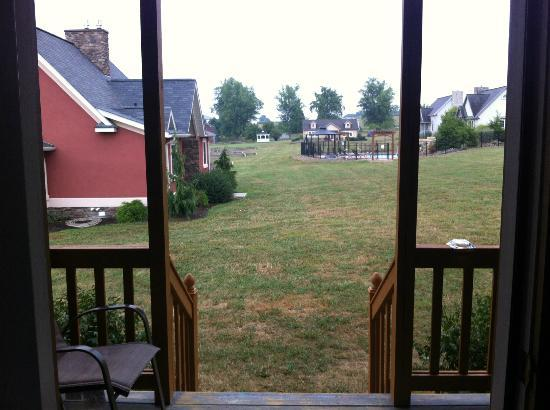 Premier Carriage House Cottages: View from Porch towards pool